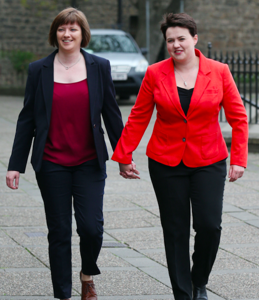 Ms Davidson said she wants to spend more time with her partner Jen Wilson and their new baby (PA)