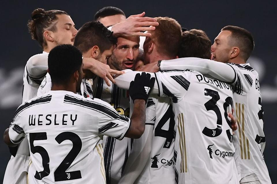 Juventus celebrate with Giorgio Chiellini (AFP)