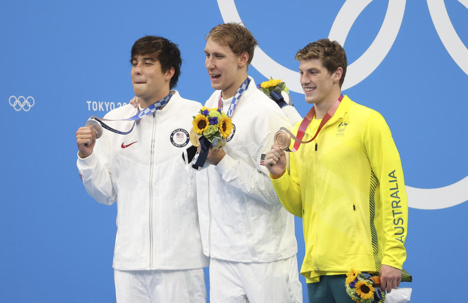TOKYO, JAPAN - JULY 25: Gold medalist Chase Kalisz of USA, silver medalist Jay Litherland  of USA, bronze medalist Brendon Smith of Australia during the medals ceremony of the 400m individual medley final on day two of the Tokyo 2020 Olympic Games at Tokyo Aquatics Centre on July 25, 2021 in Tokyo, Japan. (Photo by Jean Catuffe/Getty Images)