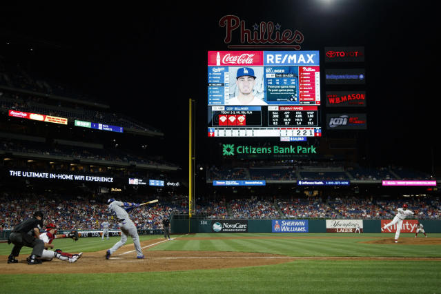Los Angeles Dodgers' Cody Bellinger, third from left, hits a home run off Philadelphia Phillies relief pitcher Edubray Ramos during the seventh inning of a baseball game, Monday, July 15, 2019, in Philadelphia. (AP Photo/Matt Slocum)