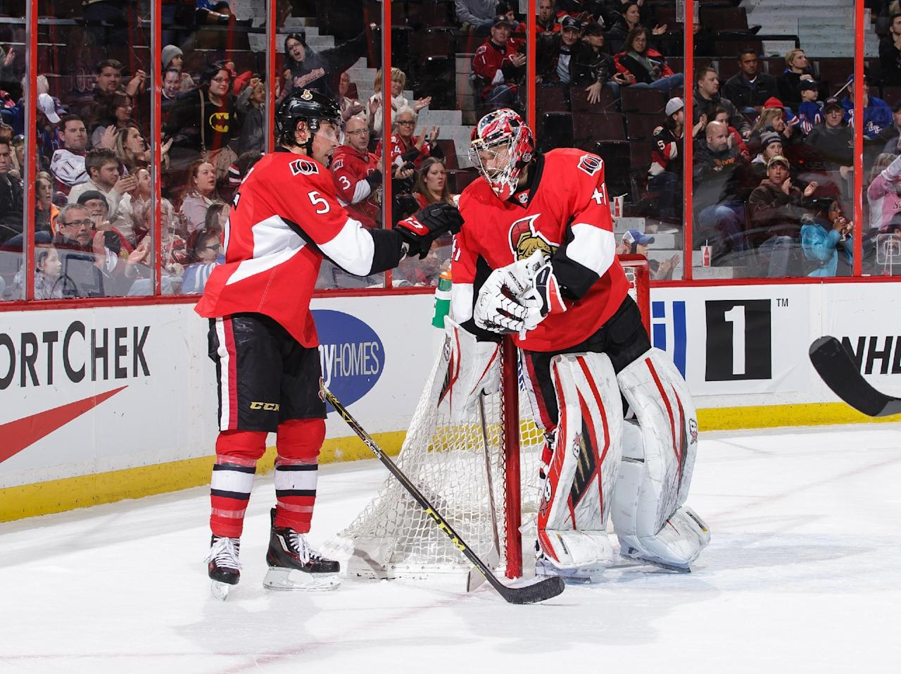 OTTAWA, ON - JANUARY 24: Cody Ceci #5 gives the puck to team mate Craig Anderson #41of the Ottawa Senators after he earned a shut-out against the New York Rangers during an NHL game at Canadian Tire Centre on January 24, 2016 in Ottawa, Ontario, Canada. (Photo by Jana Chytilova/Freestyle Photography/Getty Images)
