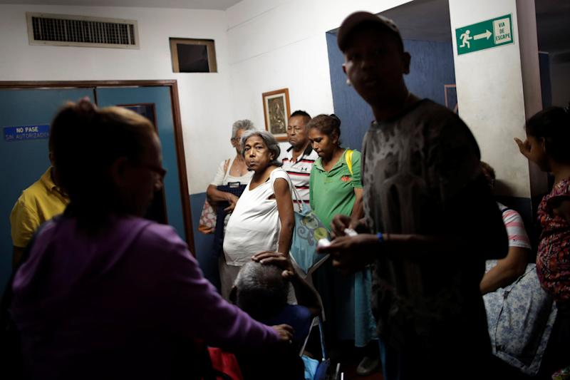 Patients with kidney disease wait with their relatives for a dialysis session at a dialysis center after a blackout in Maracaibo, Venezuela. (Photo: Ueslei Marcelino/Reuters)