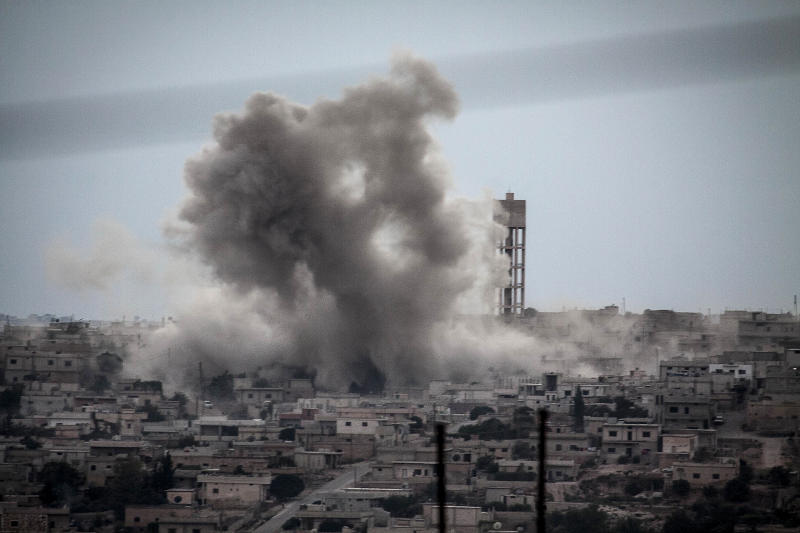 In this Sunday, Sept. 22, 2013 photo, Smoke rises from buildings from an airstrike that hit Habit village, in the Syrian central province of Hama. (AP Photo)