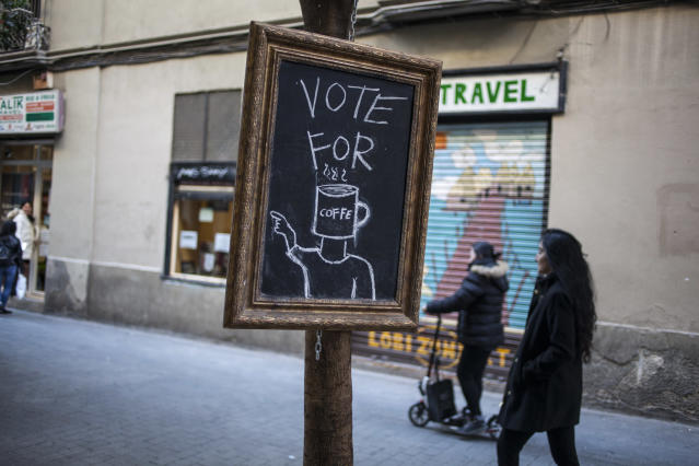 "<p>Cafeteria poster that says ""Vote for Coffee"" in Barcelona, Spain, on Dec. 21, 2017. (Photograph by Jose Colon / MeMo for Yahoo News) </p>"