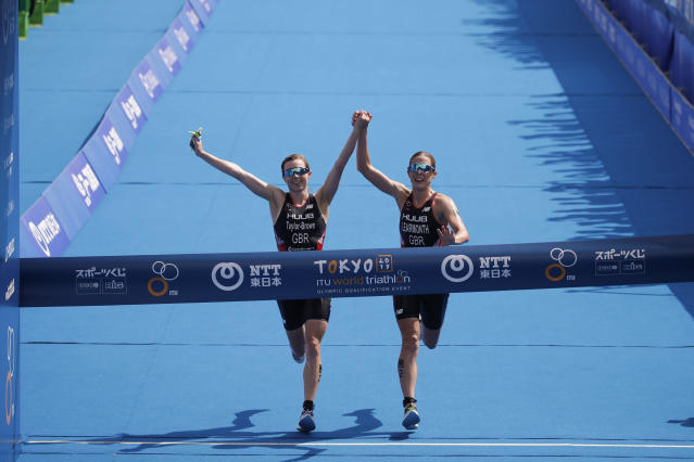 Britain's Georgia Taylor-Brown, left, and Jessica Learmonth were disqualified for crossing the finish line together at an Olympic qualification race in Tokyo. (AP Photo/Jae C. Hong)
