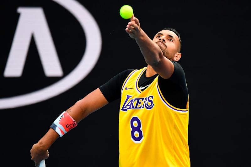 Nick Kyrgios, pictured serving during warmups, was one of many athletes to honor Bryant following his death. (Photo: WILLIAM WEST via Getty Images)
