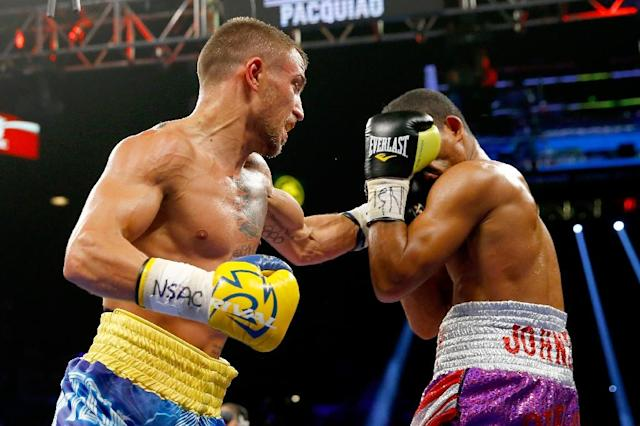 Vasyl Lomachenko, left, in action during a WBO featherweight championship fight in May 2015, is now a step closer to a clash with Guillermo Rigondeaux (AFP Photo/Al Bello)