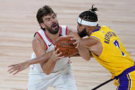 Los Angeles Lakers' JaVale McGee (7) guards Toronto Raptors' Marc Gasol during the second half of an NBA basketball game Saturday, Aug. 1, 2020, in Lake Buena Vista, Fla. (AP Photo/Ashley Landis, Pool)