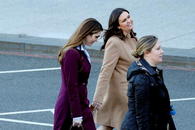 Outgoing White House Communications Director Hope Hicks (L) and White House Press Secretary Sarah Huckabee Sanders (2nd L) chat as they depart the West Wing at the White House in Washington, U.S. March 16, 2018. REUTERS/Jonathan Ernst TPX IMAGES OF THE DAY