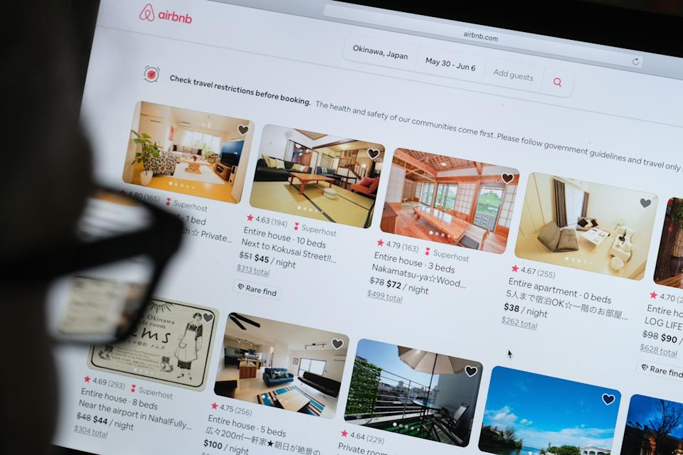 KATWIJK, NETHERLANDS - APRIL 20: In this photo illustration, a man looks at the website of Airbnb on April 20, 2020 in Katwijk, Netherlands.  (Photo by Yuriko Nakao/Getty Images)