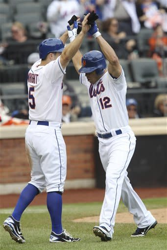 New York Mets' Scott Hairston, right, is greeted by David Wright after he hit a two-run homer during the seventh inning of the baseball game against the St. Louis Cardinals Monday, June 4, 2012, at Citi Field in New York. (AP Photo/Seth Wenig)
