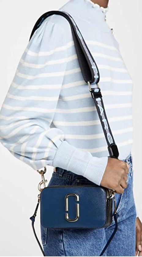 <p>This modern, versatile <span>Marc Jacobs Snapshot Camera Bag</span> ($280, originally $295) is high on our wish list.</p>