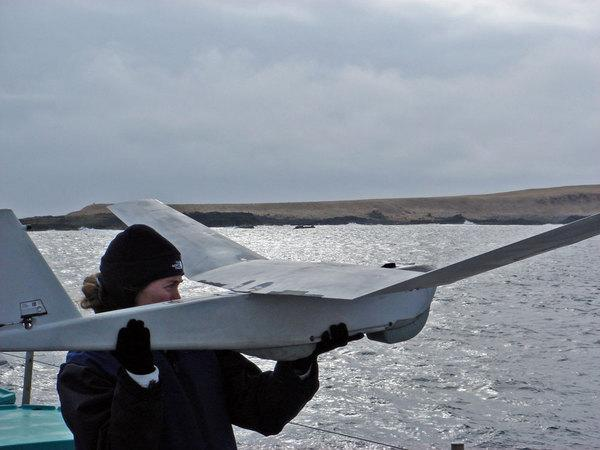 A researcher with one of the unmanned aircraft being used to survey the Steller sea lion populations