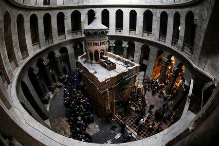 FILE PHOTO: A general view of the Edicule of the Tomb at the Church of the Holy Sepulchre in Jerusalem's Old City, February 28, 2018. Picture taken with a fish-eye lens. REUTERS/Ammar Awad/File Photo
