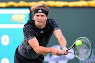 Germany's Alexander Zverev returns a shot to Andy Murray of Great Britain in a third round battle between the two most recent Olympic gold medallists at the ATP Indian Wells tournament in South California (AFP/Frederic J. BROWN)