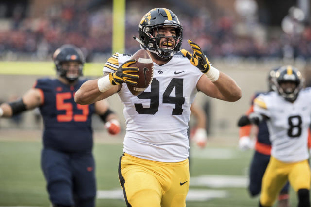 Iowa's A.J. Epenesa (94) celebrates after returning a fumble for a touchdown in the first half of a NCAA college football game against Illinois, Saturday, Nov. 17, 2018, in Champaign, Ill. (AP Photo/Holly Hart)