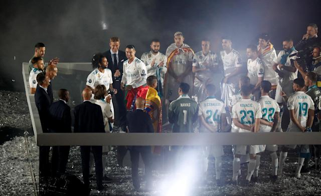 Soccer Football - Real Madrid celebrate winning the Champions League Final - Santiago Bernabeu, Madrid, Spain - May 27, 2018 Real Madrid's Cristiano Ronaldo with team mates during the victory celebrations REUTERS/Javier Barbancho