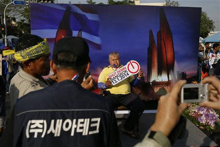 Anti-government protesters have their pictures taken inside their encampment near the Democracy monument in Bangkok