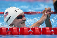 Katie Ledecky, of the United States, reacts after winning a heat of the women's 800-meter freestyle at the 2020 Summer Olympics, Thursday, July 29, 2021, in Tokyo, Japan. (AP Photo/Charlie Riedel)