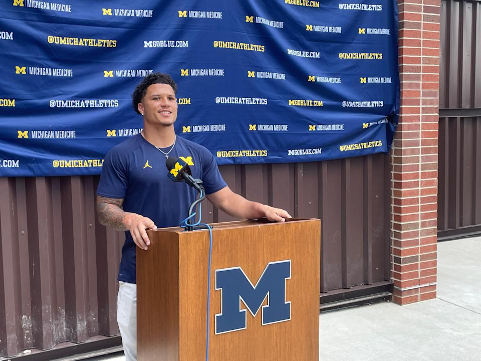 Michigan running back Blake Corum talks Aug. 20, 2021 to reporters outside of Schembechler Hall.