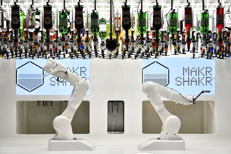 There are robots of all shapes and sizes, including a large mechanical arm that mixes and shakes cocktails (AFP Photo/Ben STANSALL)