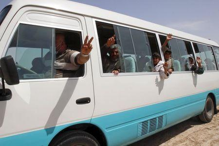 Members of the Yazidi minority sect who were newly released are seen in a vehicle on the outskirts of Kirkuk April 8, 2015. REUTERS/Ako Rasheed