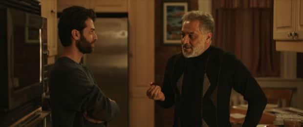 Ayham Abou Ammar (left) portrays Tareq Hadhad in the film, while the late Hatem Ali (right) portray's Tareq's father, Assam.
