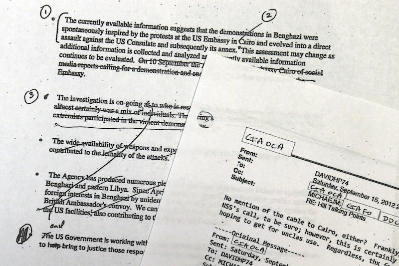 A portion of pages of emails that the White House released Wednesday, May 15, 2013, that document how the Obama administration crafted its public talking points immediately following the Sept. 11, 2012, deadly attack on a U.S. diplomatic post in Benghazi, Libya, are seen at the White House in Washington. (AP Photo/Jacquelyn Martin)