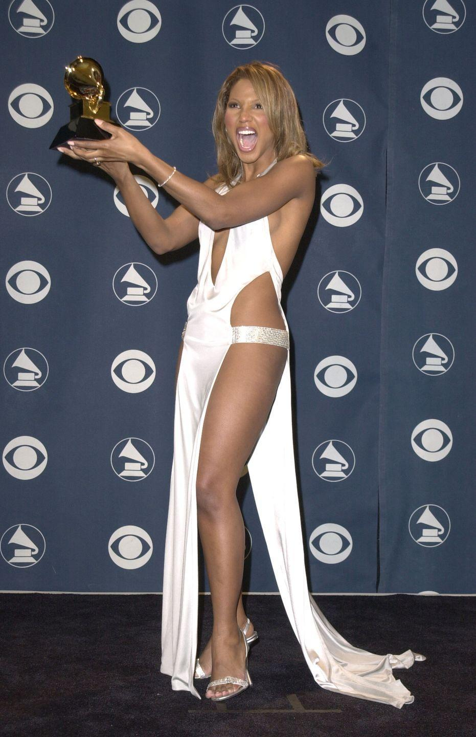 """<p>Braxton bared lots of skin in this Richard Tyler design that she wore to the 2001 Grammys. Although it was a successful night (she <a href=""""https://www.grammy.com/grammys/awards/43rd-annual-grammy-awards-2000"""" rel=""""nofollow noopener"""" target=""""_blank"""" data-ylk=""""slk:won the Grammy for Female R&B Vocal performance"""" class=""""link rapid-noclick-resp"""">won the Grammy for Female R&B Vocal performance</a>), one critic <a href=""""https://products.kitsapsun.com/archive/2001/02-23/0051_grammy_awards__toni_braxton_was_d.html"""" rel=""""nofollow noopener"""" target=""""_blank"""" data-ylk=""""slk:wrote"""" class=""""link rapid-noclick-resp"""">wrote</a> that the dress """"made the attractive Braxton look as though she had yards of toilet paper stuck in all the wrong places.""""</p>"""