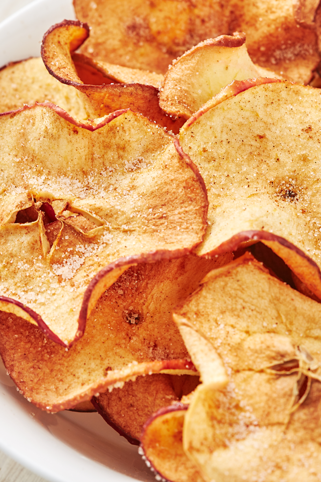"<p>Making your own apple crisps is very easy and it's a delicious healthy snack to have on hand and not to mention, one of our favourite apple recipes.</p><p>Get the <a href=""https://www.delish.com/uk/cooking/recipes/a28995950/healthy-apple-chips-recipe/"" target=""_blank"">Apple Crisps</a> recipe.</p>"
