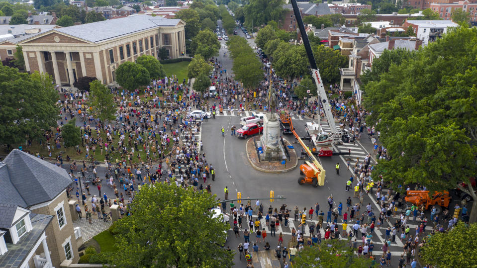 FILE - This Wednesday July 1, 2020, file photo shows workers preparing to remove the statue of Confederate General Stonewall Jackson from its pedestal on Monument Avenue in Richmond, Va. Devon Henry, whose company handled the summer removals of Richmond's Confederate monuments, spoke with The Associated Press about navigating safety concerns for himself and his crew and previously unreported complexities of the project. (AP Photo/Steve Helber)