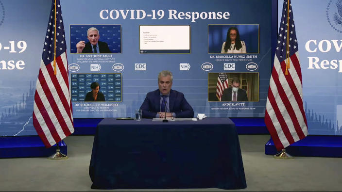 In this image from video, Jeff Zients, White House coronavirus response coordinator, speaks as Dr. Anthony Fauci, director of the National Institute of Allergy and Infectious Diseases and chief medical adviser to the president., Dr. Marcella Nunez-Smith, chair of the COVID-19 health equity task force, Dr. Rochelle Walensky, director of the Centers for Disease Control and Prevention, and Andy Slavitt, senior adviser to the White House COVID-19 Response Team,, appear on screen during a White House briefing on the Biden administration's response to the COVID-19 pandemic Wednesday, Jan. 27, 2021, in Washington. (White House via AP)