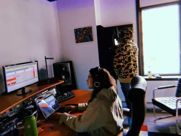 Artist Kwabid Nicholas from Tobique First Nation standing at the mic recording his latest single at  Renegade Sound Studios in Fredericton.  (Submitted by Kwabid Nicholas - image credit)