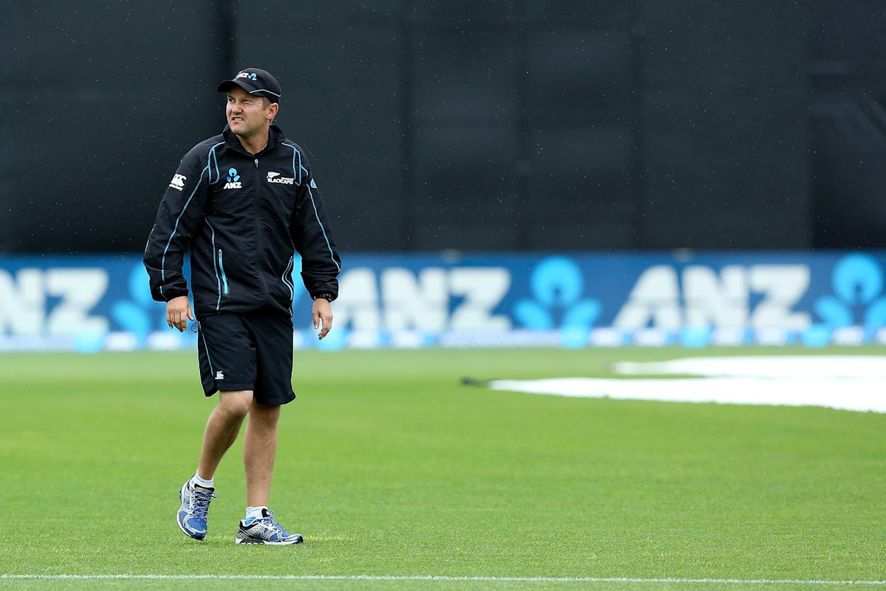NAPIER, NEW ZEALAND - DECEMBER 29:  Coach Mike Hesson of New Zealand looks on during during a rain delay prior to the start of game two of the One Day International series between New Zealand and the West Indies at McLean Park on December 29, 2013 in Napier, New Zealand.  (Photo by Hagen Hopkins/Getty Images)