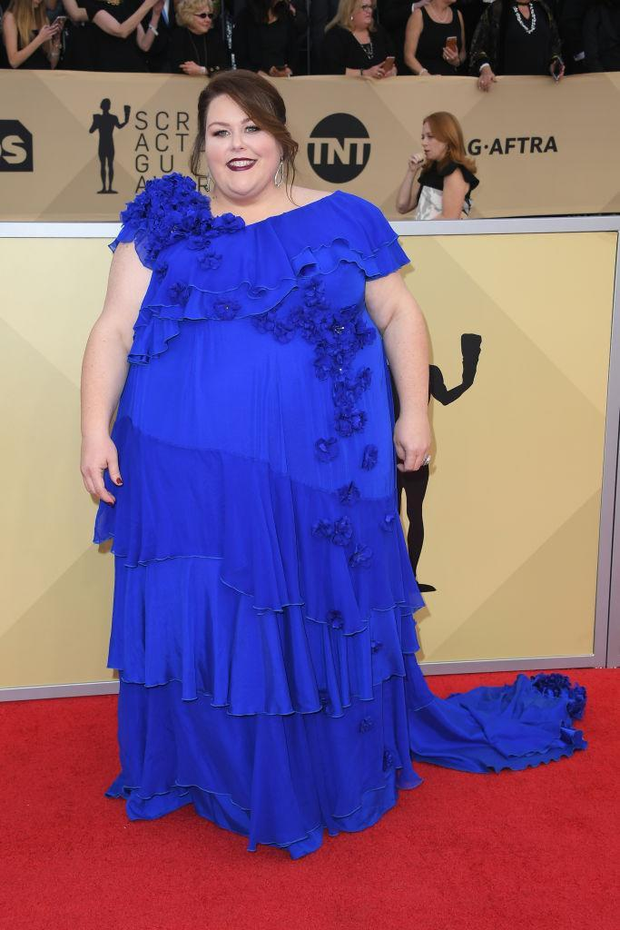 <p>Metz rocked a royal blue tiered dress with floral decor. (Photo: Getty Images) </p>