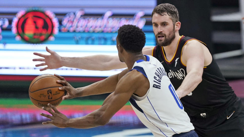 Cleveland Cavaliers' Kevin Love (0) defends against Dallas Mavericks' Josh Richardson (0) during the first half of an NBA basketball game Sunday, May 9, 2021, in Cleveland. (AP Photo/Tony Dejak)