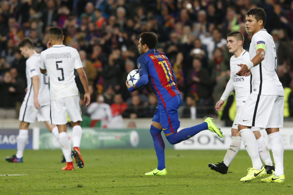 Barcelona's Brazilian forward Neymar (C) celebrates after scoring a penalty kick past dejected PSG players during the UEFA Champions League round of 16 second leg football match FC Barcelona vs Paris Saint-Germain FC at the Camp Nou stadium in Barcelona on March 8, 2017. / AFP PHOTO / PAU BARRENA        (Photo credit should read PAU BARRENA/AFP/Getty Images)