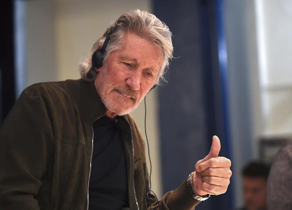 British rock icon and activist Roger Waters gives his thumb up during a conference on Palestinian situation and Human Rights at the Uruguayan unions' organisation (PIT-CNT) headquarters in Montevideo, on 2 November, 2018 (Getty Images)