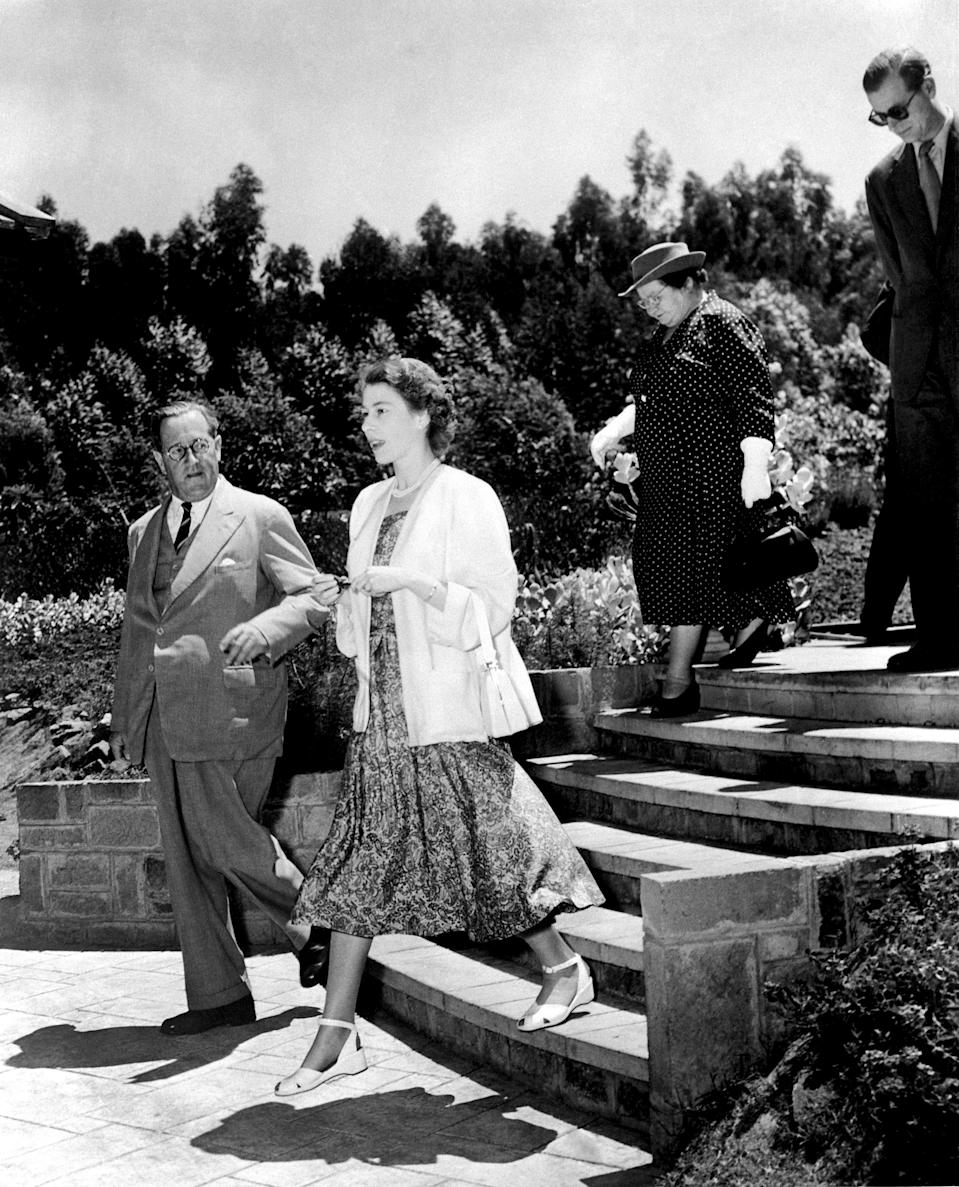 Princess Elizabeth and the Duke of Edinburgh (behind) arrive in Nairobi for their Commonwealth Tour.   (Photo by PA Images via Getty Images)