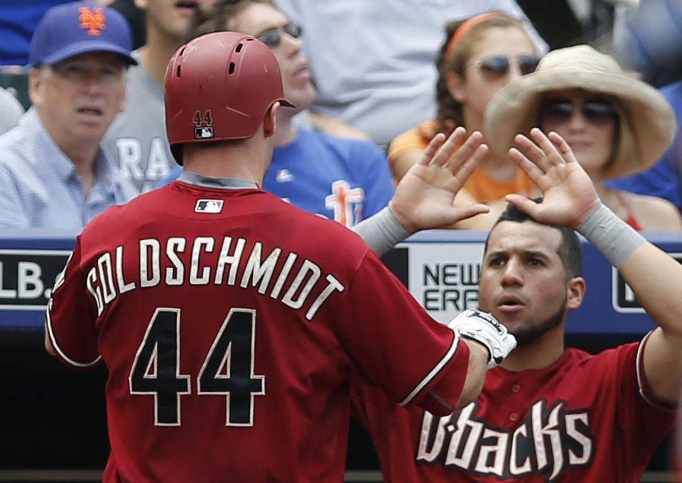 A teammate greets Arizona Diamondbacks Paul Goldschmidt (44) at the dugout steps after Goldschmidt hit a third-inning solo home run in a baseball game against the New York Mets in New York, Sunday, July 12, 2015. (AP Photo/Kathy Willens)