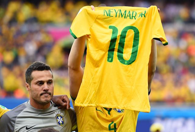 <p>Brazil stars hold up Neymar's shirt in memory of the injured star – who was ruled out of the remainder of the tournament in the hosts' win over Colombia. </p>