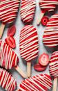 """<p>These strawberry-vanilla pops look absolutely divine! Everyone will think you bought them at the store, but they're entirely homemade.</p><p><strong>Get the recipe at <a href=""""https://mikebakesnyc.com/strawberry-vanilla-bean-ice-cream-pops-with-strawberry-magic-shell/"""" rel=""""nofollow noopener"""" target=""""_blank"""" data-ylk=""""slk:Mike Bakes NYC"""" class=""""link rapid-noclick-resp"""">Mike Bakes NYC</a>.</strong></p><p><strong><a class=""""link rapid-noclick-resp"""" href=""""https://go.redirectingat.com?id=74968X1596630&url=https%3A%2F%2Fwww.walmart.com%2Fsearch%2F%3Fquery%3Dpopsicle%2Bsticks&sref=https%3A%2F%2Fwww.thepioneerwoman.com%2Ffood-cooking%2Fmeals-menus%2Fg32109085%2Ffourth-of-july-desserts%2F"""" rel=""""nofollow noopener"""" target=""""_blank"""" data-ylk=""""slk:SHOP POPSICLE STICKS"""">SHOP POPSICLE STICKS</a><br></strong></p>"""