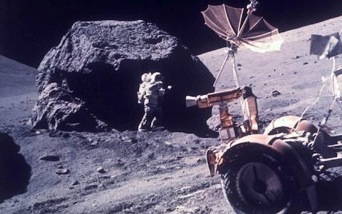 Harrison Jack Schmitt taking samples from a boulder which never saw sunlight - Credit: Nasa