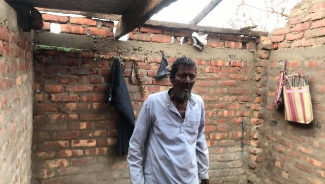 Shaikh Abdullah's neighbour waits for his son to return for lunch to a battered home