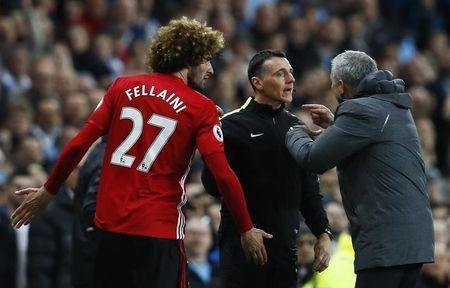 Britain Soccer Football - Manchester City v Manchester United - Premier League - Etihad Stadium - 27/4/17 Manchester United's Marouane Fellaini after being sent off with manager Jose Mourinho and fourth official Neil Swarbrick Action Images via Reuters / Jason Cairnduff Livepic