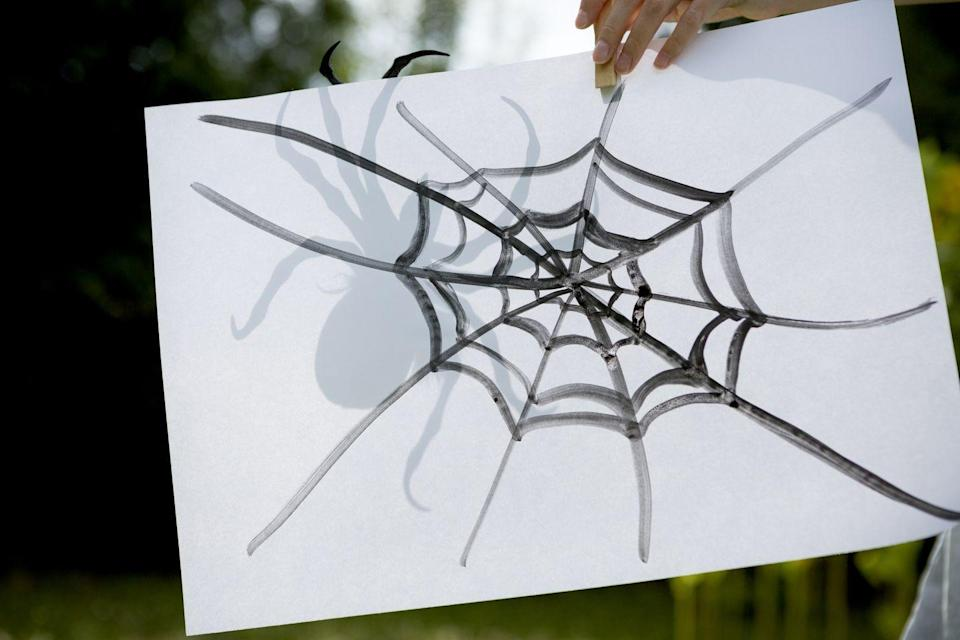 <p>To play this classic game, draw a spiderweb onto a roll of paper or piece of cardboard, and attach the paper to a wall. Give each player a cutout spider with a piece of double-sided tape on the back and have them pin the spider onto the web. Whoever gets closest to the center of the web wins.</p>