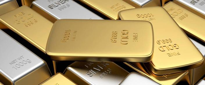 Rows of gold and silver bars with several thin bars