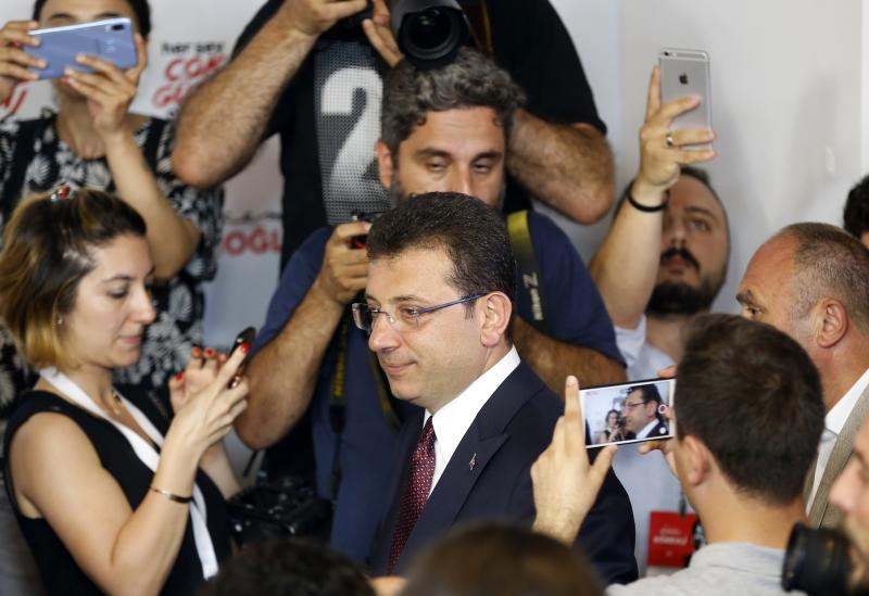 Ekrem Imamoglu candidate of the secular opposition Republican People's Party arrives for statements at CHP offices in Istanbul, Sunday, June 23, 2019. The opposition candidate declares second victory in Istanbul mayor's race, says democracy prevailed in rerun election. (AP Photo/Lefteris Pitarakis)