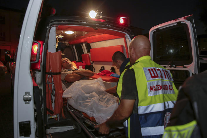 <p>Injured person is taken to ambulance after a missile from Gaza Strip hit in the town of Sderot, Israel, Wednesday, Aug. 7, 2018. (Photo: Yehuda Peretz/AP) </p>