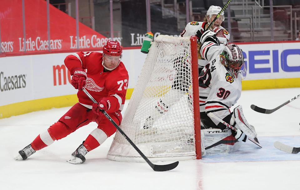 Detroit Red Wings left wing Adam Erne (73) shoots against Chicago Blackhawks goaltender Malcolm Subban (30) on Saturday, April 17, 2021, at Little Caesars Arena in Detroit.